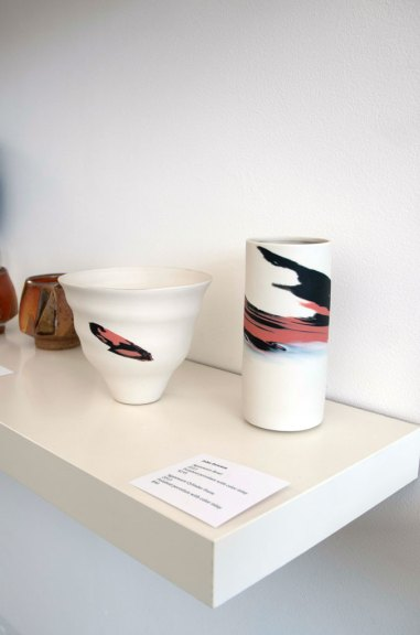 John Dawson, Agateware Bowl and Agateware Cylinder form, 2013. Polished porcelain with color inlay, Madison Metro photograph