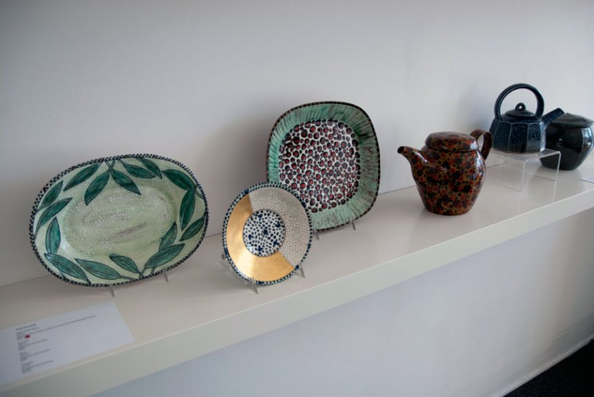 Gail Kendall, Half-Gold Dish, 2012. Slipped terracotta with 22 karat burnished gold luster; Leaves, 2013, Slipped terracotta; Dots, 2013, Slipped terracotta; Teapot, 2014. Slipped terracotta, Madison Metro photograph