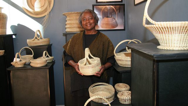 Mary Jackson with her baskets. Jennifer Gerardi photograph, Craft in America