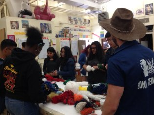 3-D sculpture students gathering their yarn to crochet