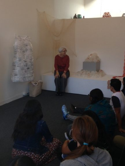 Carrie Ann Burckle sits to the right of her piece, Shift
