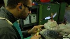 Kyle Ostwalt solders a valve casing. Mark Markley photograph