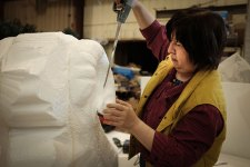 Yumei Hou sculpting a sheep