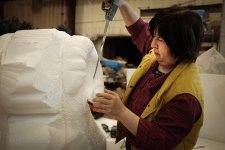 Yumei Hou sculpting a sheep