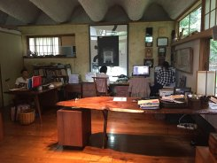 Mira's office. Her grandson Toshi is at the desk at left and her interns are at work on design