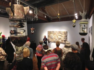 Jenn Hassin discusses her work at the opening