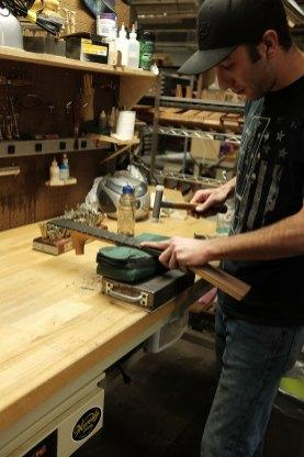 Bart Buschi hammers the frets. Mark Markley photograph