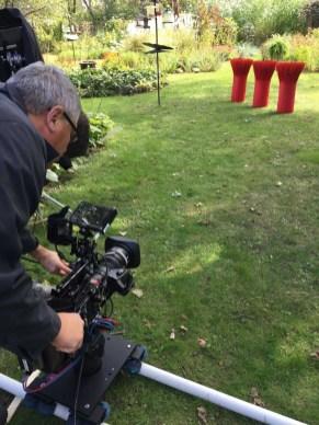 Filming Merkel-Hess work outdoors