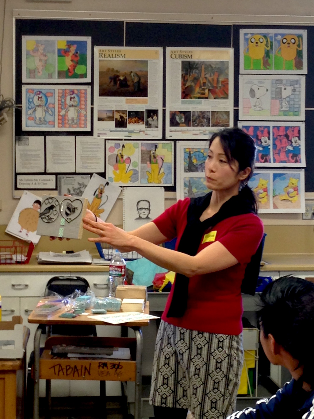 Yamamoto teaches local Van Nuys High School students about carved wood block traditions and printmaking.