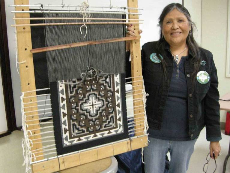 Barbara Teller Ornelas with her weaving in process