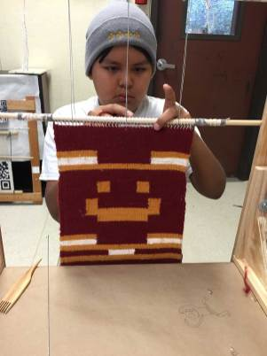 Weaving his first rug