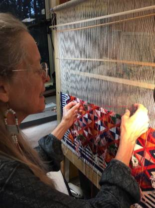 Weaving student and her intricate design