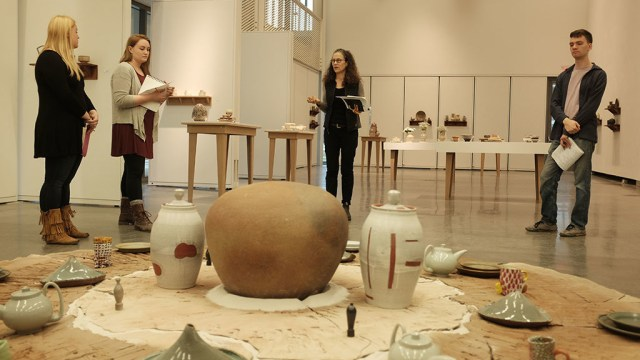 Linda Sikora, Professor of Ceramic Arts at Alfred University, works with her senior students