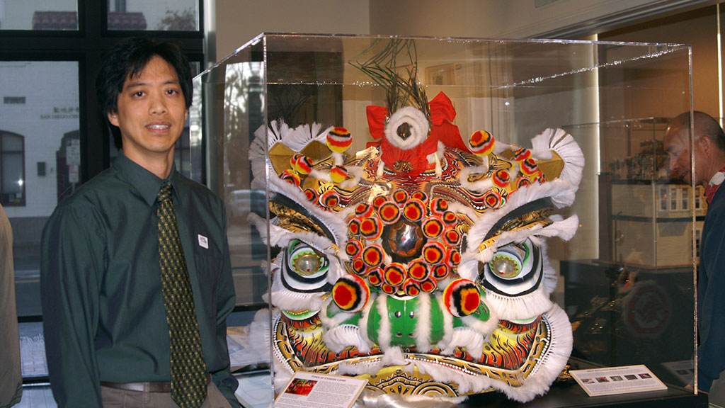 Chris Low with his lion heads