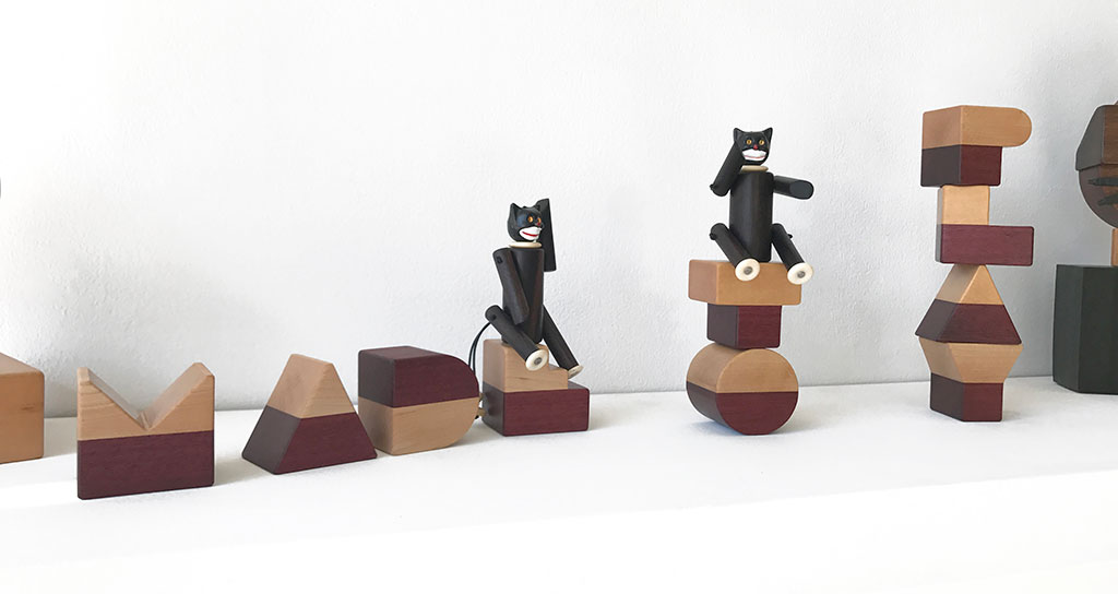 Made to Play, Pamela Weir-Quiton, Cupcake Cats / prototypes, 2018. Ebony with white bone paws and a plastic cupcake topper, elastic, Craft in America
