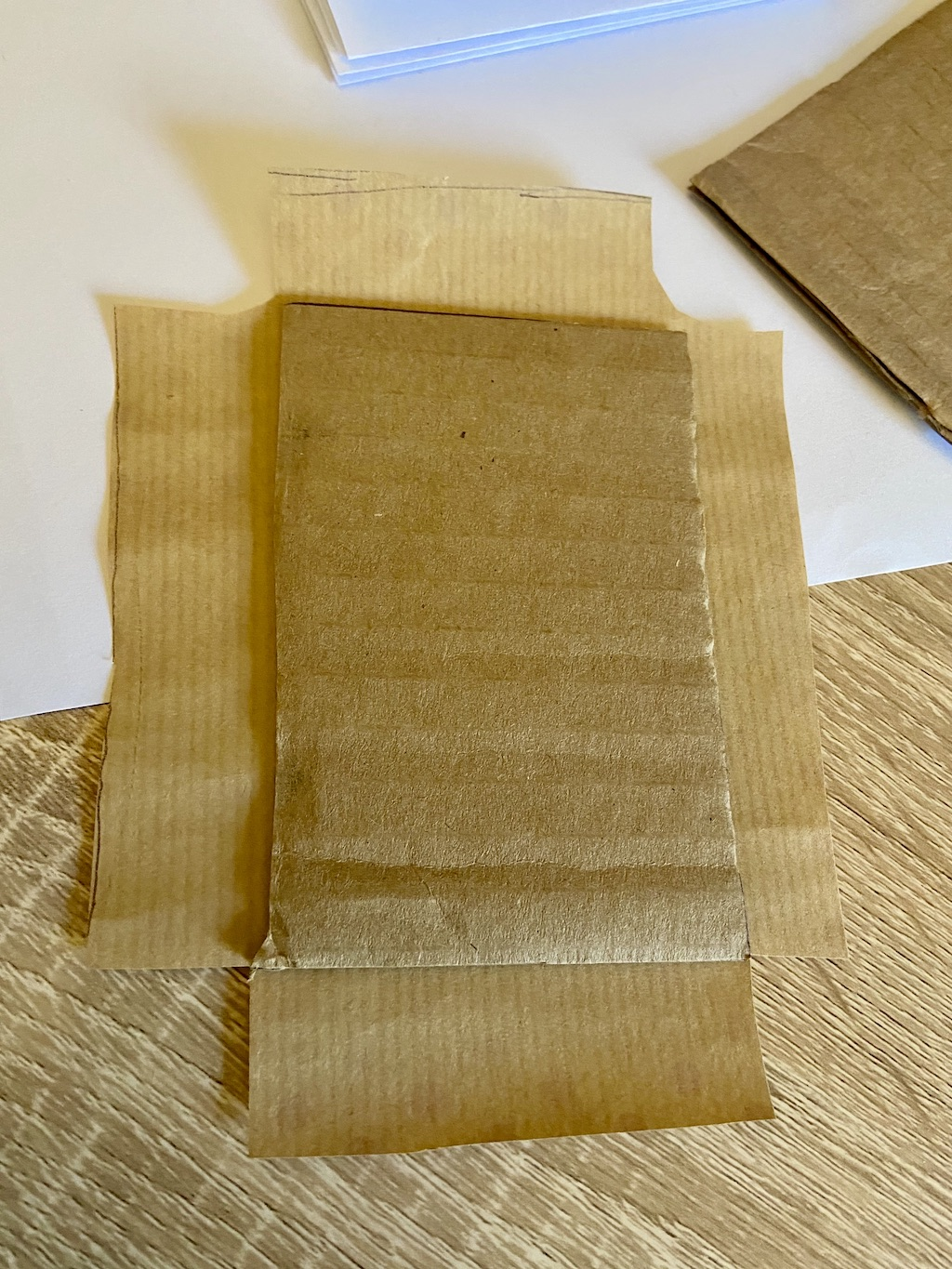 Glue your cardboard in the center of the scrap or wrapping paper, decorative side out.