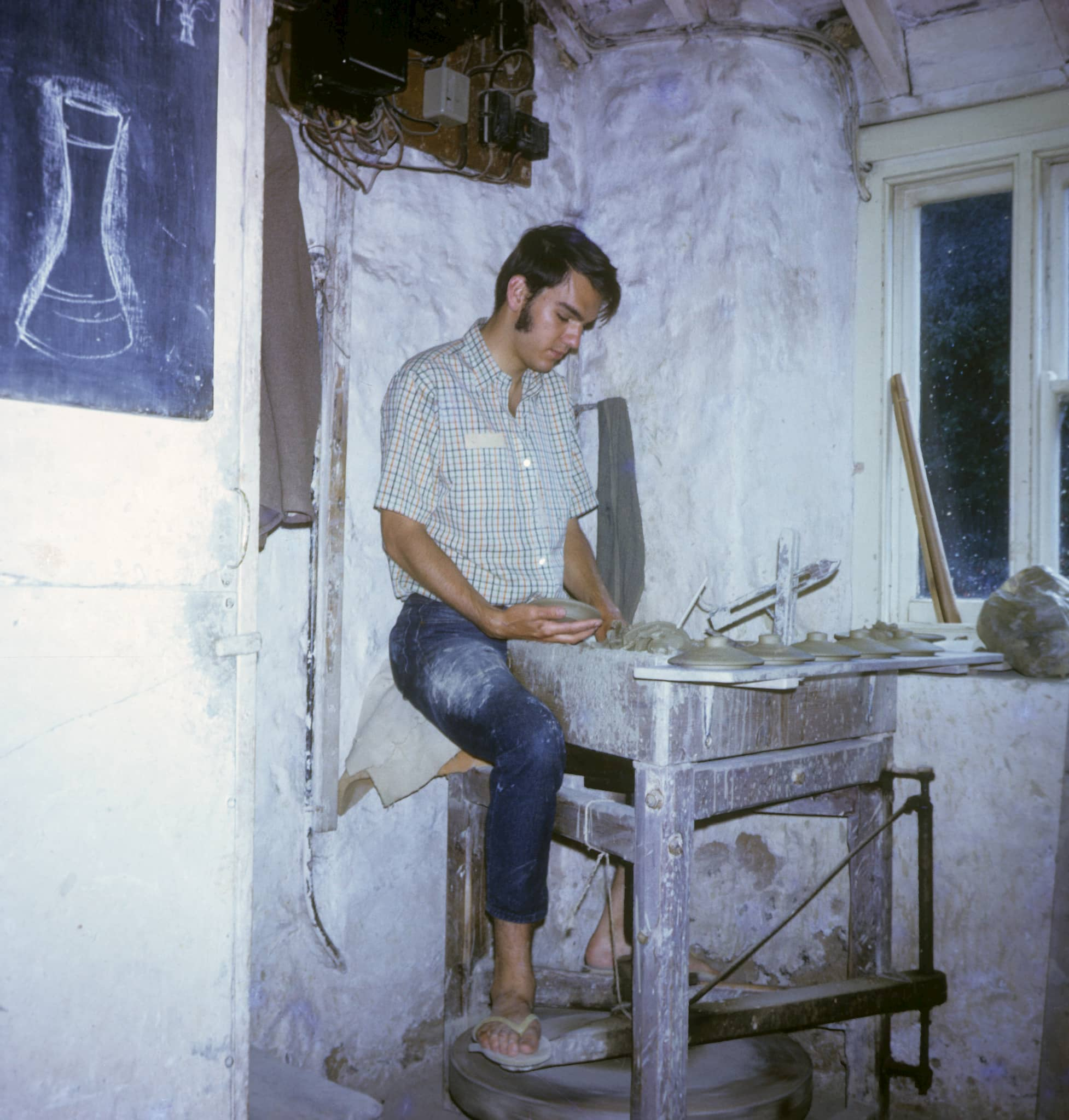 Jeff Oestreich at the potter's wheel at Leach Pottery, 1970. Courtesy of Jeff Oestreich. Craft in America CROSSROADS