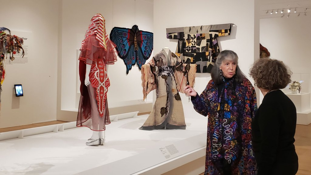 Gallerist and craft historian Julie Schafler Dale with Senior Curator of Costumes and Textiles Dily Blum in the Off the Wall: American Art to Wear exhibition at the Philadelphia Museum of Art. Craft in America STORYTELLERS