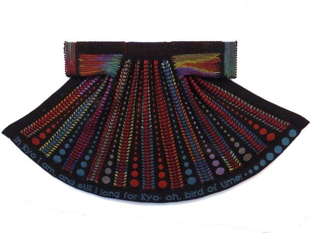 Linda J. Mendelson, In Kyo Kawara coat. Courtesy of the artist. Craft in America STORYTELLERS