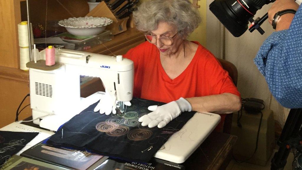 Fiber artist Linda J. Mendelson at the sewing machine. Craft in America STORYTELLERS