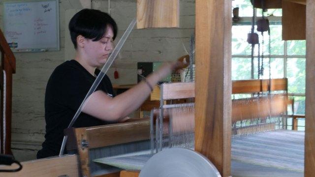 Berea College student in the Weaving Studio. Craft in America DEMOCRACY