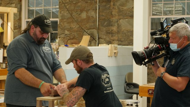 Luthiers Nathan Smith and Jeremy Haney work together to build a mountain dulcimer at the Troublesome Creek Stringed Instrument Company in Hindman, Kentucky. Denise Kang photo. HARMONY episode of Craft in America