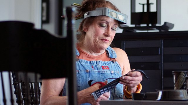 Harriete Estel Berman uses black plastic to create her jewelry. Denise Kang photo. JEWELRY episode of Craft in America