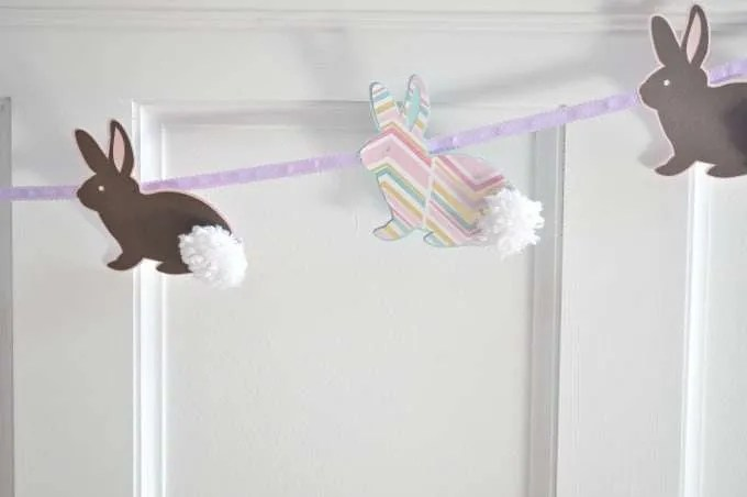 Adorable Fun Bunny Banner for Easter with cute little pom-pom tails. Easter decorations gets the kids all excited for coming spring and Easter celebration.