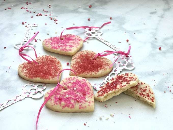 Perfect Valentines Heart Shortbread Cookies on a white counter with a polka dot key tag that says love.