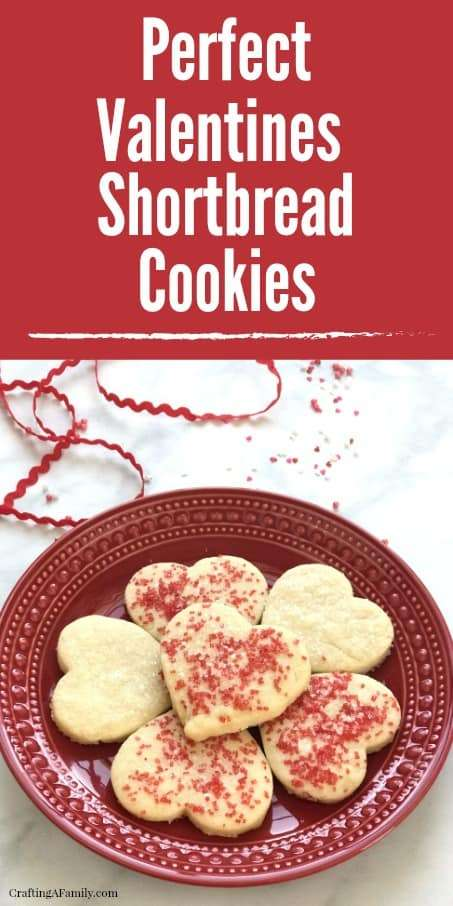 6 Perfect Valentines Heart Shortbread Cookie on a red plate with red and white sprinkles and a red rick rack ribbon.