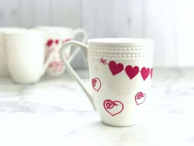white coffee mug with pink vinyl hearts open hearts and a heart banner trim