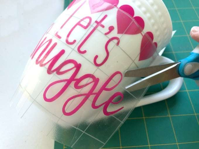 White coffee mugs with pink and red hearts and heart banner on a white background.
