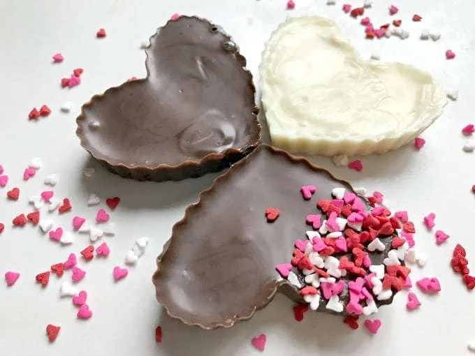 Fun Valentines Party Ideas white and chocolate heart shaped candies with heart sprinkles