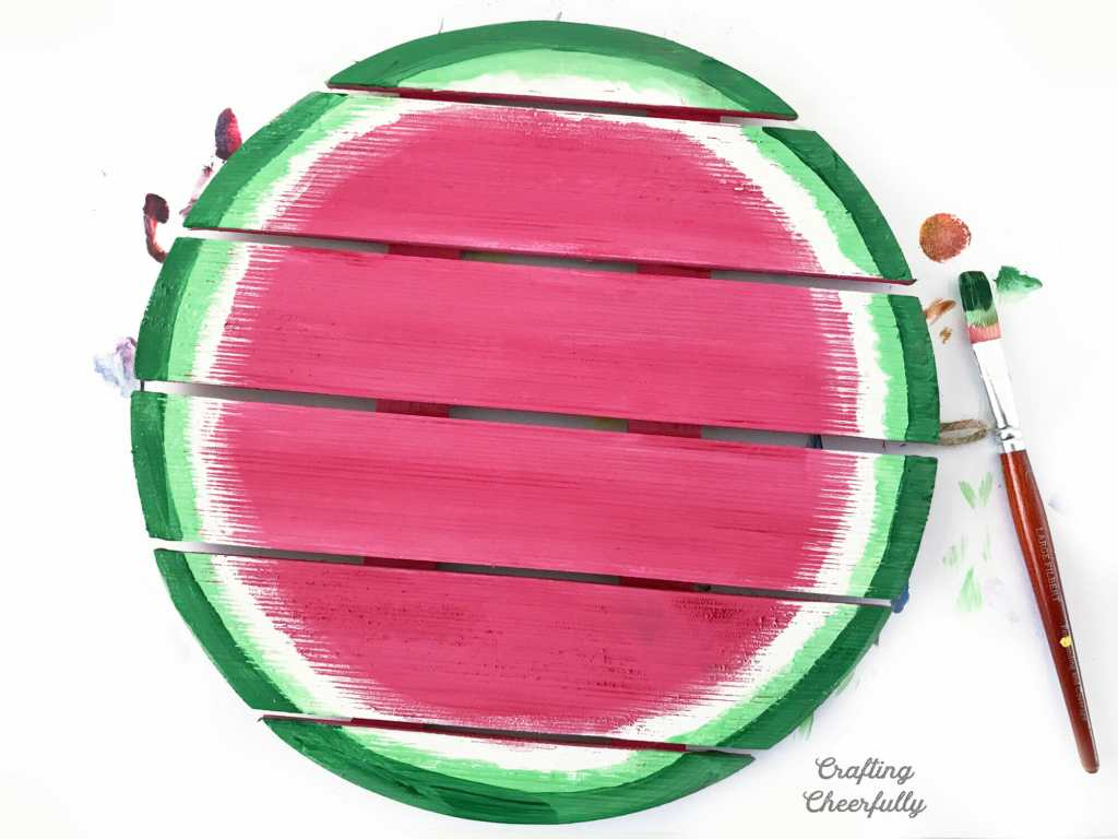 A darker green is applied to the border of the watermelon sign so it goes dark green, light green, white and the the giant pink center.