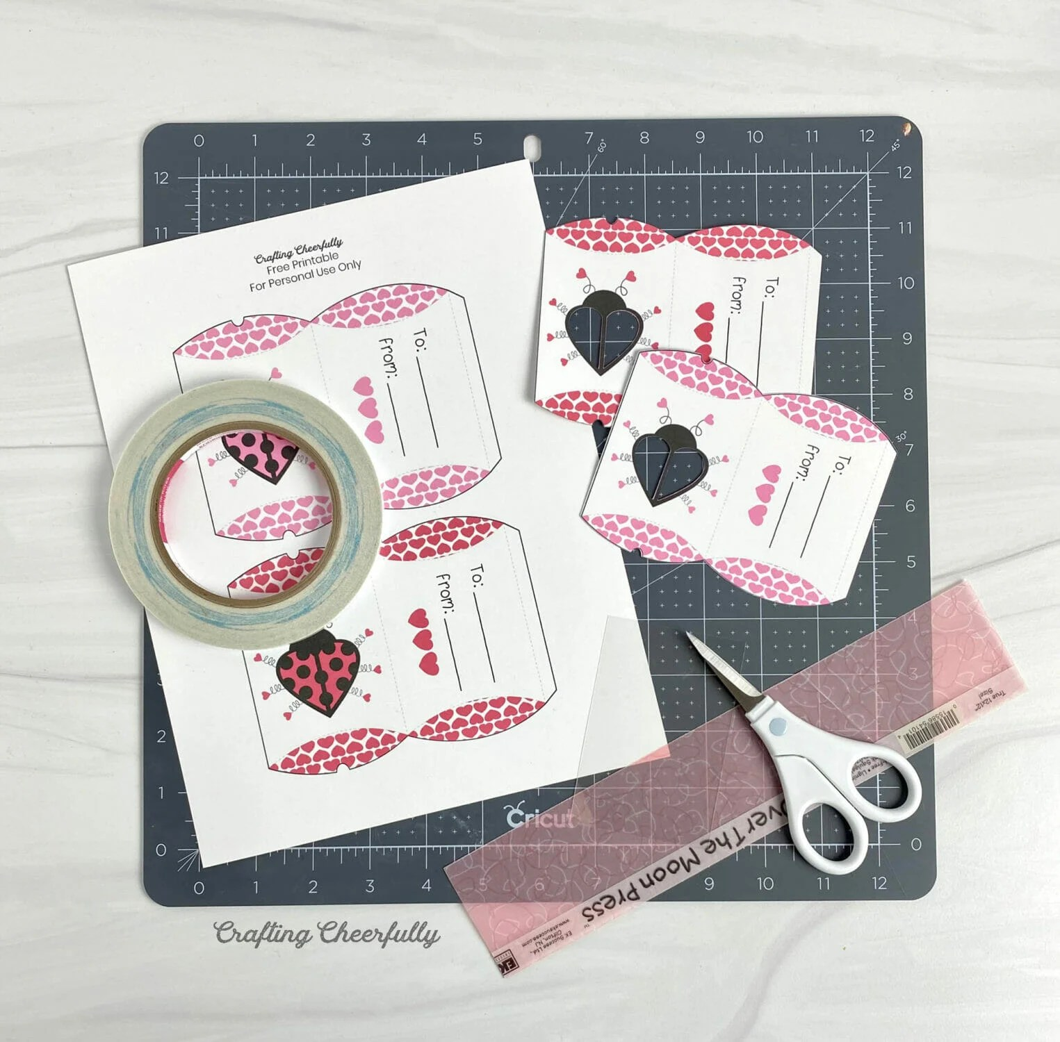Supplies to make the Love Bug Pillow Boxes including free printable.