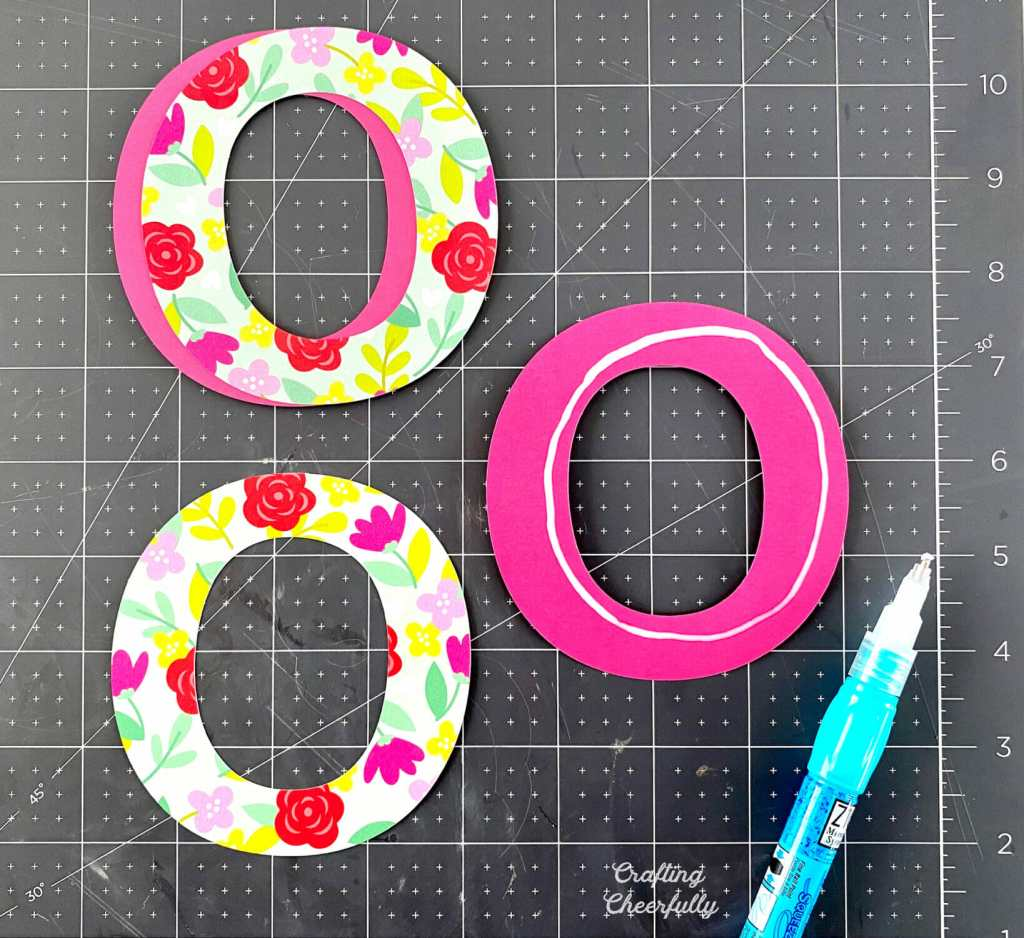 Glue is applied to O letters so they can be layered.