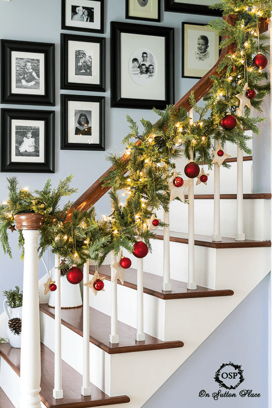 Christmas entryway decor with garland and lights
