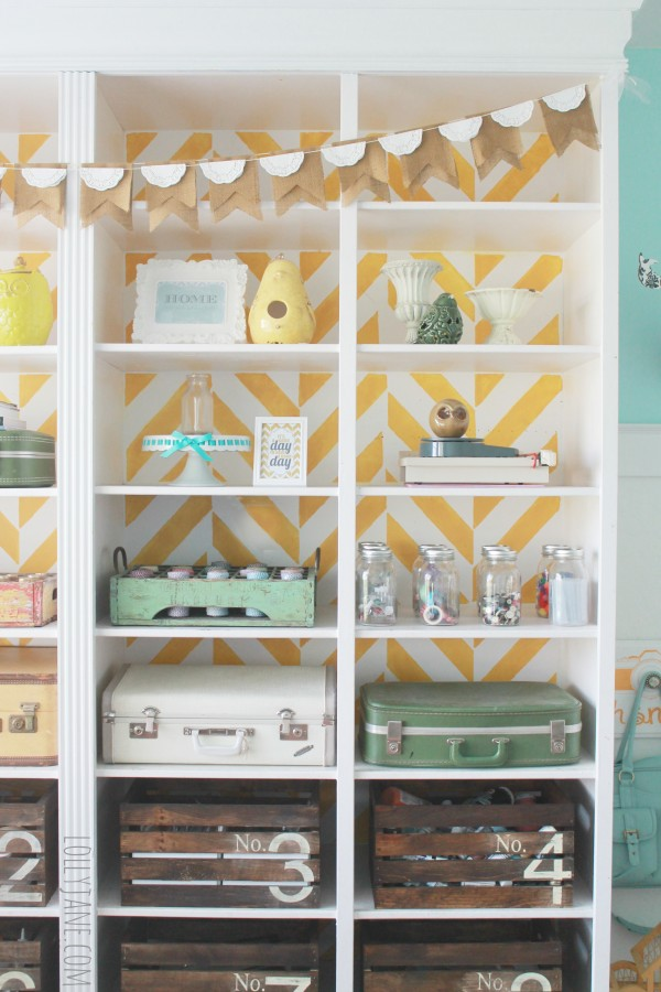 Stencil painted backed bookcase styling