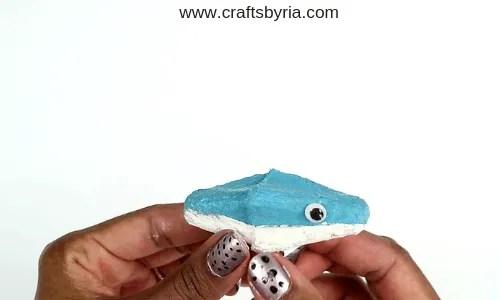 egg carton shark-step3- stick googly eyes