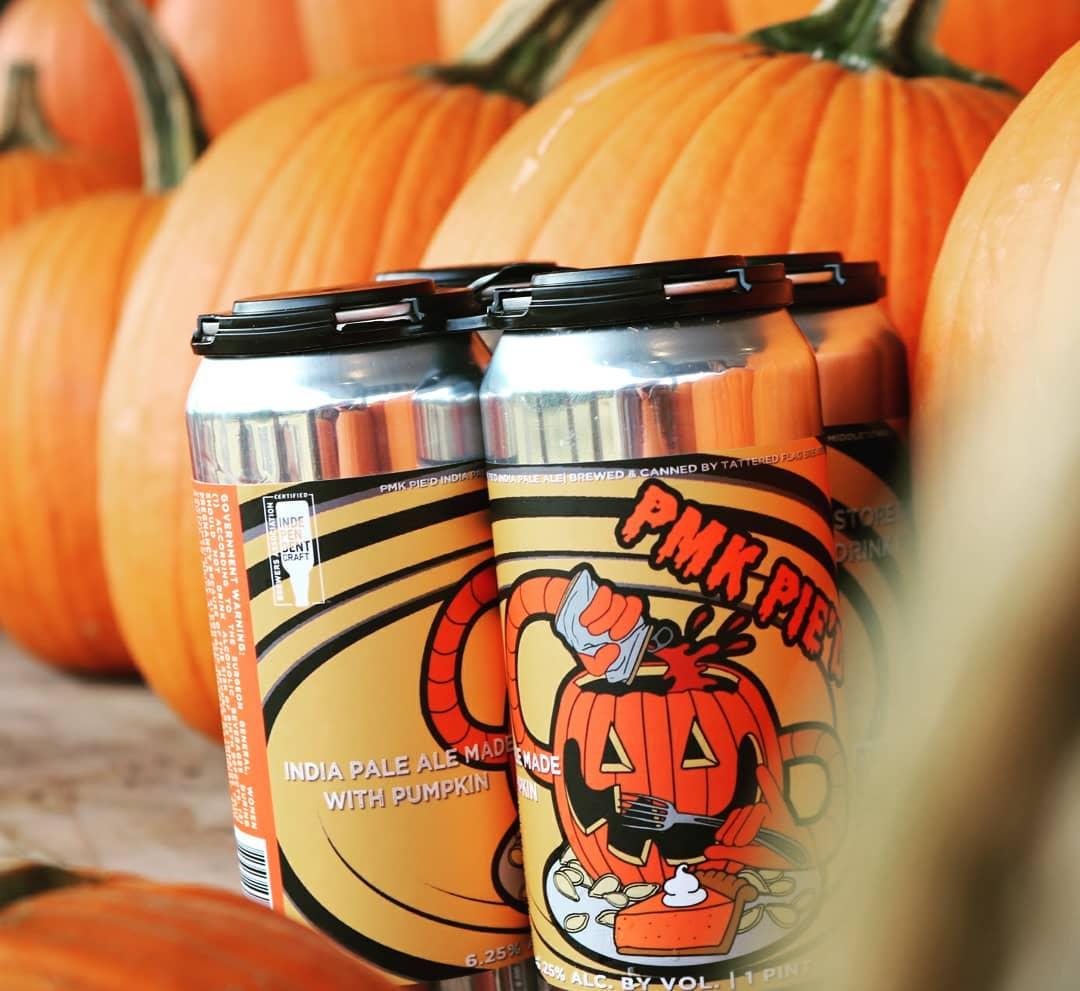 Pumpkin IPA can in a pumpkin patch