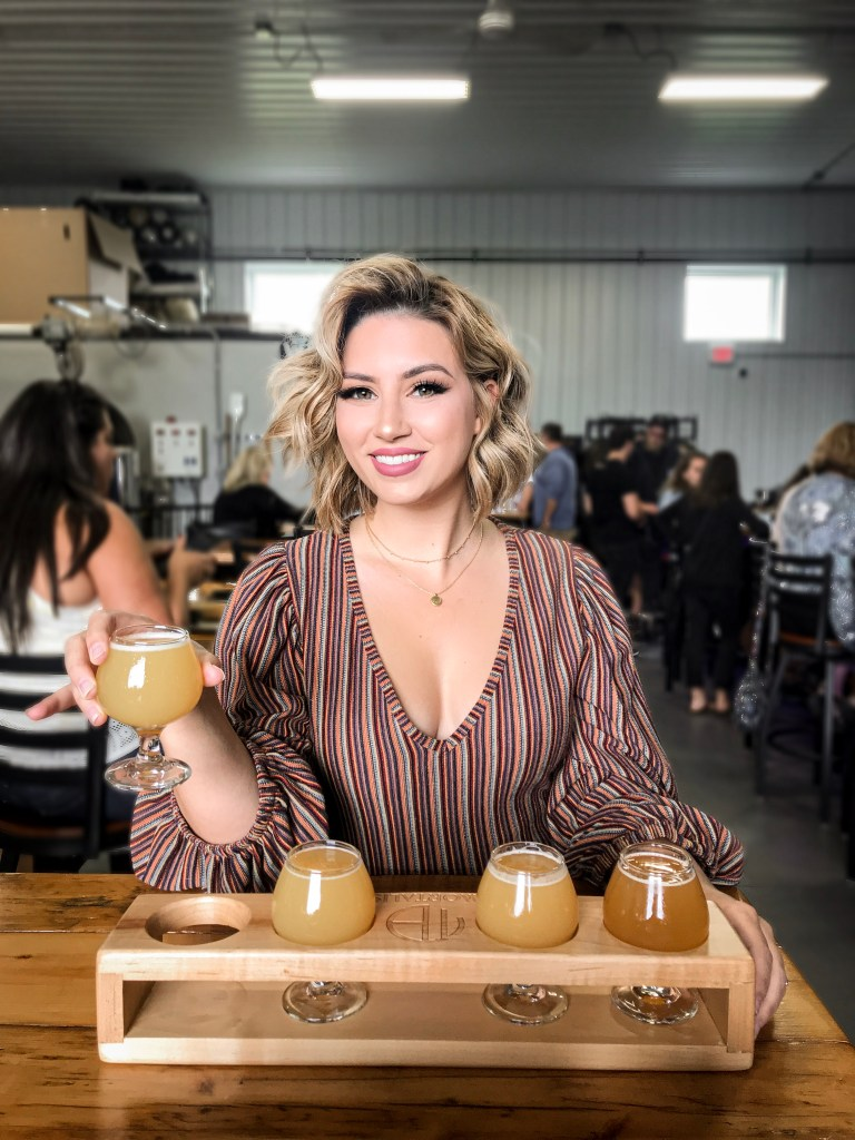 Beer blogger Sarah Calandra enjoying a flight of beers at her local Rochester brewery.