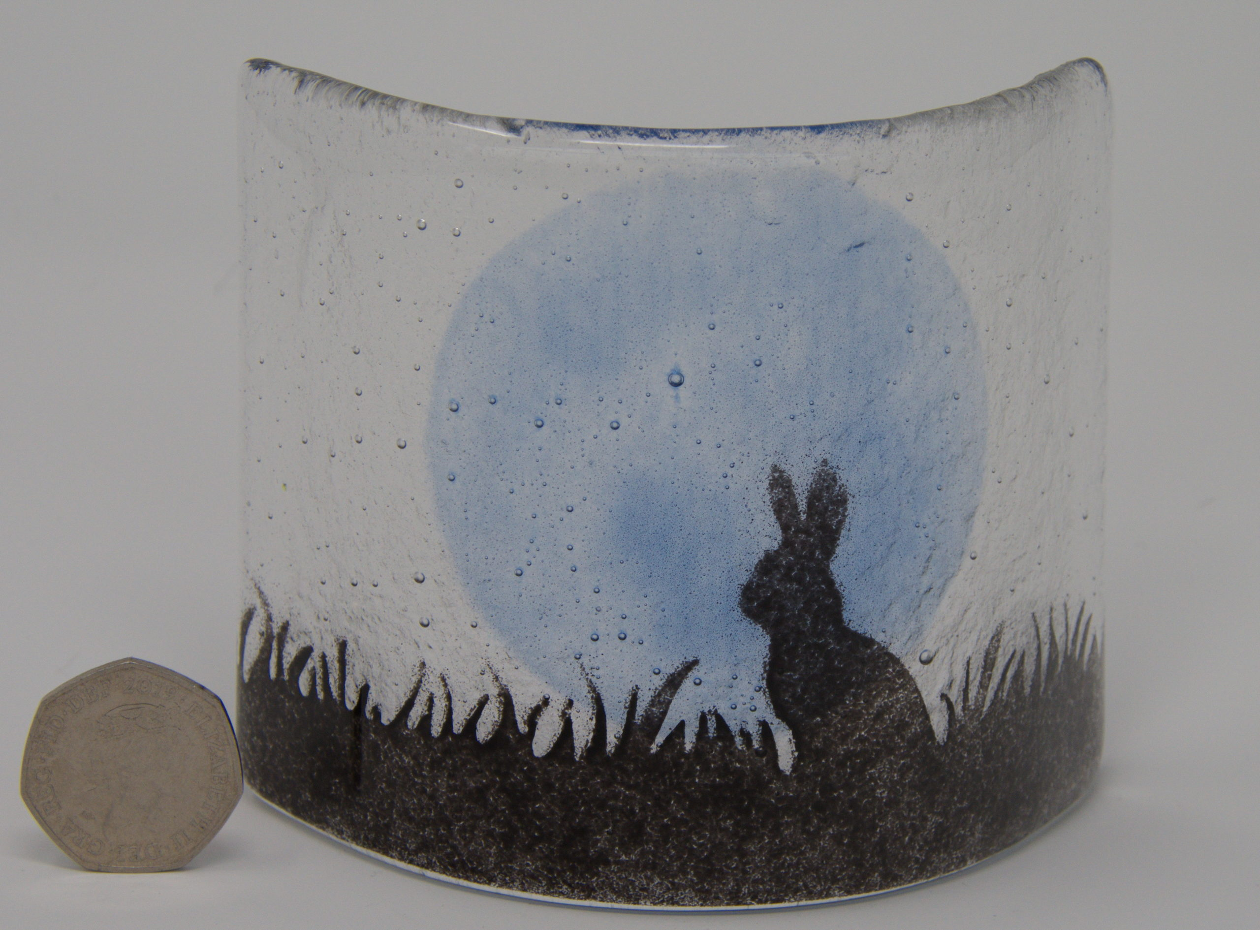 Hare in front of a full moon
