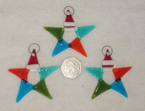 Glass multi coloured stars with Santa hats