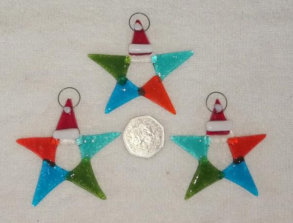 Glass multi coloured stars with Santa hats