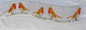 Colourful Robins on a free standing glass wibble