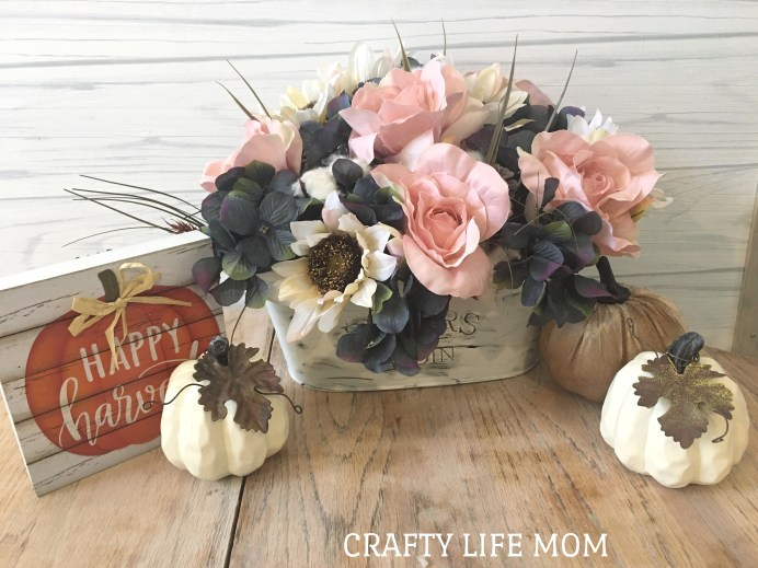 DIY Fall Floral Arrangement made using mostly items form the Dollar Tree. Create beautiful flowers for your home and enjoy them all season long.