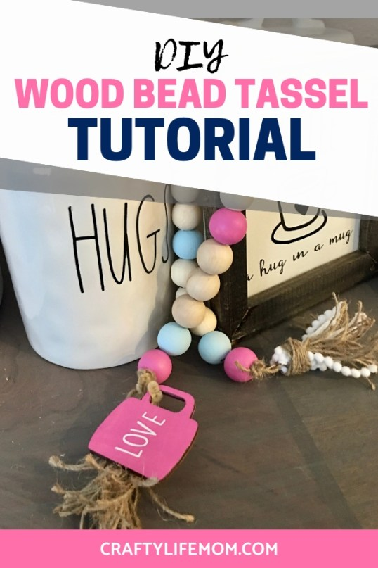 Learn how to make this quick and easy painted DIY Wood Bead Tassel. You can make this using some items from the Dollar Tree, your local crafts and even with items from Amazon. Display the tassel bead strand with your home decor items, coffee mugs, and so much more. #diywoodbeadtassel #woodbeads #homedecordiy #woodbeadgarland #woodbeadgarlanddiy #woodbeadcrafts