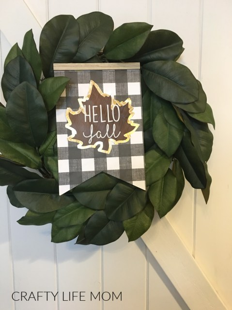 Farmhouse DIY using items mostly from the Dollar Tree. Create this super cute Hello Fall Farmhouse sign using this tutorial.