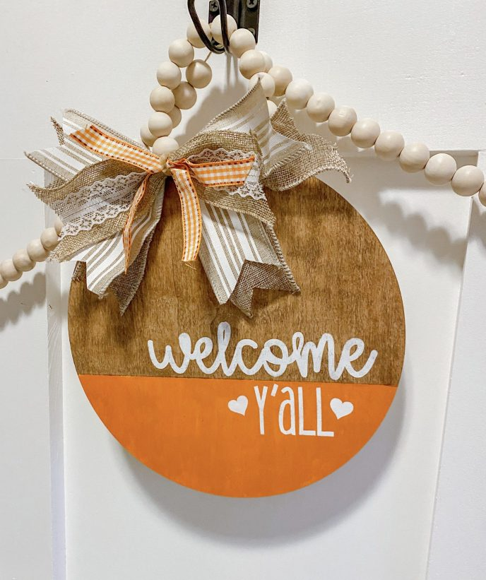 Create this Welcome Y'all Fall themed door hanger using this simple to use and easy DIY kit. Kit includes stencil and easy to create materials to hang this door hanger in your entryway this fall. #craftkits #falldeccor #fallcraftkit #fallhomedecor
