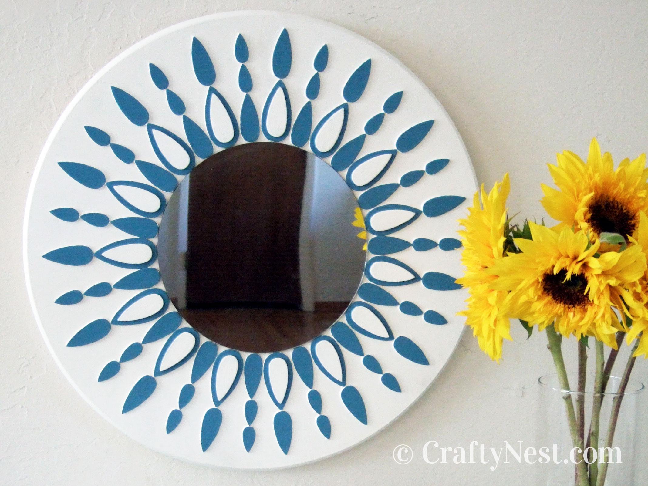 Painted sunburst mirror on the wall, photo